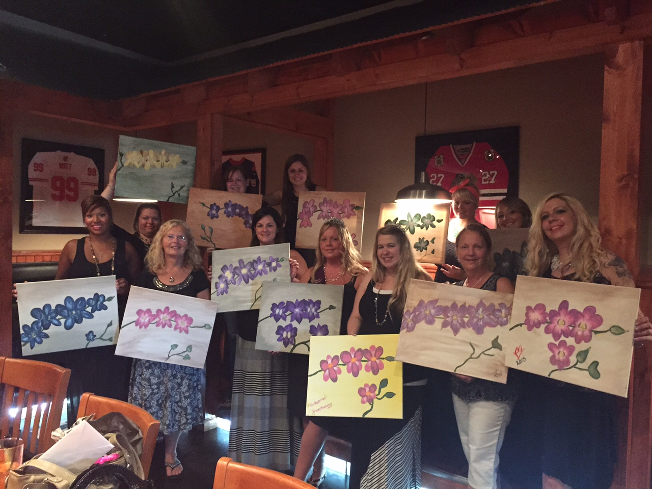 The ladies at this Bachorlette Party painted colorful Orchids for a night of fun! 7/18/15